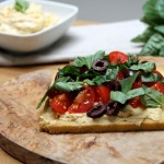 Hummus Tartine with an Olive, Tomato, Lemon and Basil Salsa